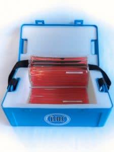 Valise de transport ISOS 03 chargée avec une plaque eutectique rouge